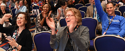 conference attendees cheering
